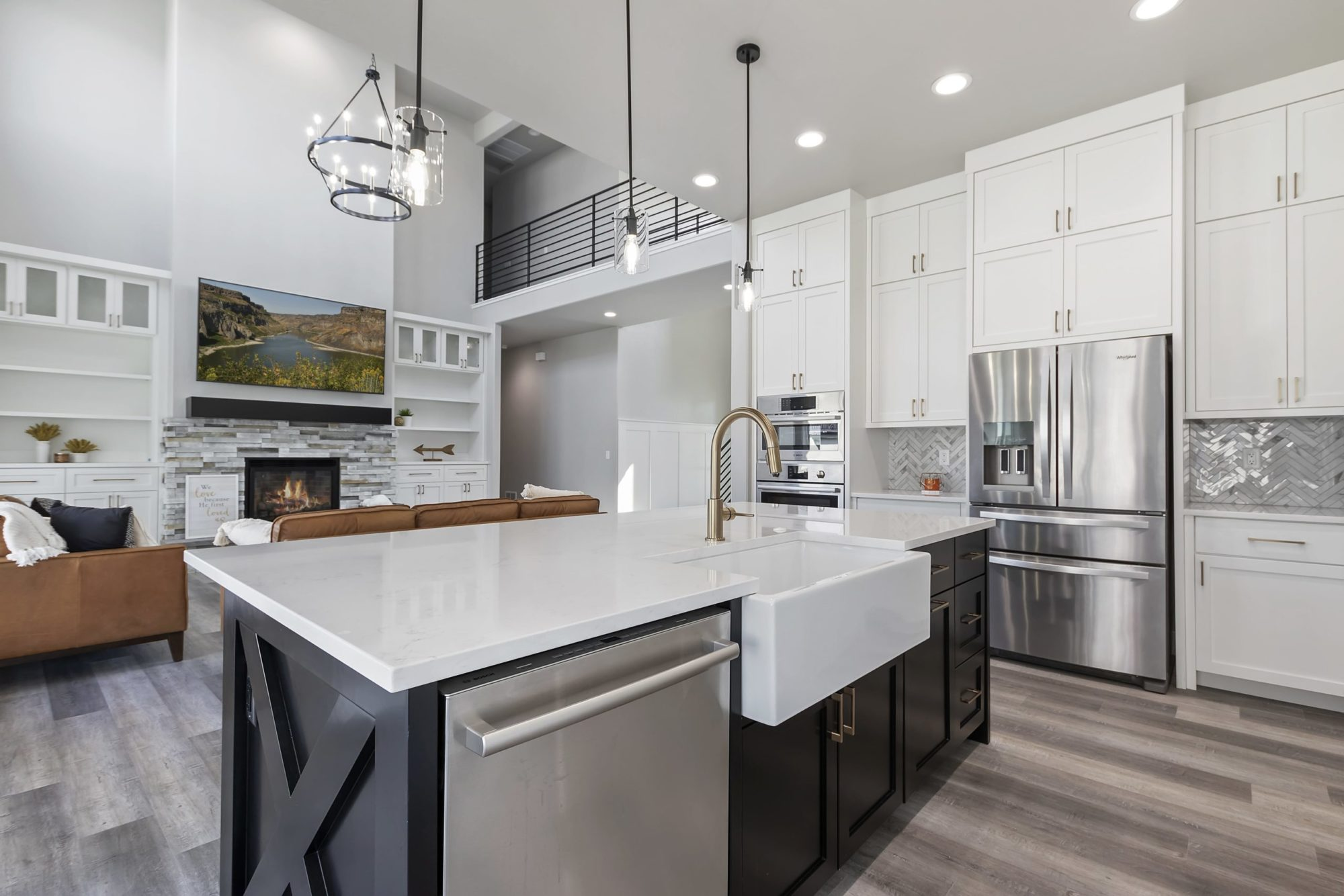 A Luxurious looking kitchen with unique cabinets and drawers throughout the area